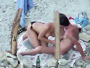 Oral sex på stranden er filmet voyeur